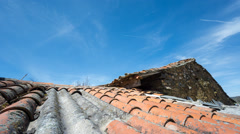 Clouds over tile roof, Time Lapse Stock Footage