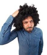 Funny man with the wig while scratching head Stock Photos
