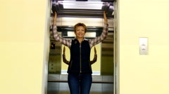 Woman hold the lift doors - stock footage