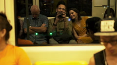 EDITORIAL Couple with camera sitting in metro during train ride HD Stock Footage