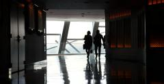 Silhouette of Passengers Walking at an Airport Stock Video 4K Stock Footage