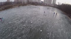 Children skating on icy pond at winter evening. Stock Footage