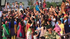 Indian people preparing to celebrate daily closing of Indian - Pakistani border Stock Footage