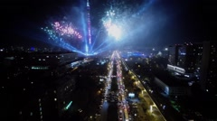 Projectors beams and sparks of fireworks on dark sky - stock footage
