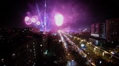 Fireworks light up dark sky near Ostankinskaya TV tower Stock Footage