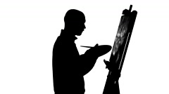Talanted painter continues drawing a painting by oil paints holding the palette Stock Footage