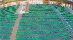 Empty tribunes on soccer stadium at autumn day. Aerial view Stock Footage