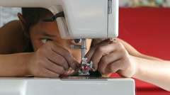 Little Asian Girl Using A Sewing Machine-Close Up Stock Footage