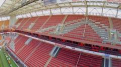 Banners above empty tribunes of football stadium Locomotive Stock Footage