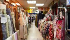 Vivid fabrics at Youngle Market, short move in passageway Stock Footage
