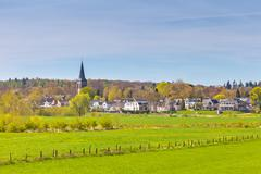 The small Dutch village of Dieren in front of the Veluwe - stock photo
