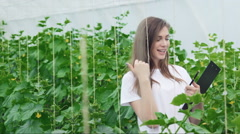 The girl between rows of greenery thumbs up Stock Footage