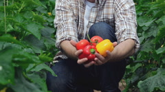Guy raises vegetables directly to the camera Stock Footage