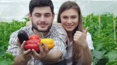 Guy shows healthy vegetables and the girl thumbs up Stock Footage