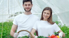 Man and woman farmers after harvest smiling directly at the camera Stock Footage