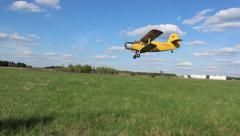 Plane lands on the field Stock Footage