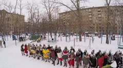 Row of people in armour with shields and swords wait - stock footage