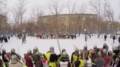 Two rows of people in armour with shields and swords wait for fight - stock footage
