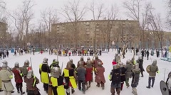 Stock Video Footage of Two group of people in armour with shields and swords start fight