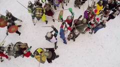 Group of people fight in medieval style battle at winter day. - stock footage