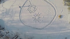 Picture with sun and flower created on snow at winter Stock Footage