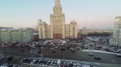 Transport traffic on Garden Ring near skyscraper of soviet era Stock Footage