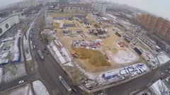 City traffic near building site of dwelling complex at winter Stock Footage