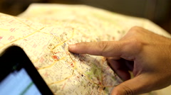 Navigating with a Map Stock Footage