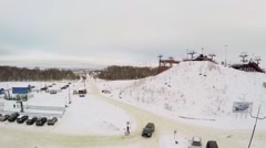 Skiing resort with chairlift on small hill covered by snow Stock Footage