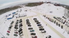 Skiing resort with large car parking and chairlift on small hill Stock Footage