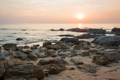 HDR photo of stones at sunset shore Stock Photos
