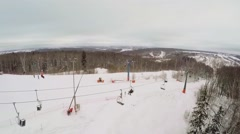Skiing resort with several chairlifts on snow slope at winter Stock Footage
