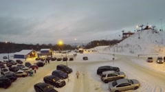 Car parking with illumination near chairlift on snow slope Stock Footage