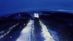 Skiing resort with illuminated snow slopes at winter evening Stock Footage