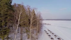 Sunshades on quay of snowbound river Istra at winter Stock Footage