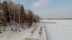Embankment with sunshades near snowbound river Istra Stock Footage