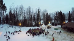 Stock Video Footage of Lot of tourists get fun on fair during Pancake Week at winter
