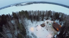 Stock Video Footage of Many people get fun during fair on shore of snowbound river
