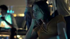 Pensive, sad woman sitting on terrace in cafe at night  HD Stock Footage