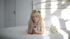 Attractive young woman using app on smartphone in the bedroom. Stedicam shot Stock Footage