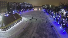 People skating by ice rink at Chistye Prudi in Moscow Stock Footage