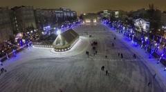 People with kids slide on skates by ice rink on Chistye Prudi Stock Footage