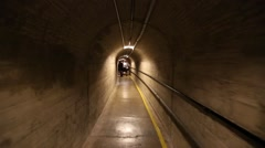 Hoover Dam walking through deep curved concrete hallway - stock footage