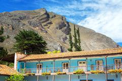 Old colonial building with hills rising high above in Tarma, Peru - stock photo