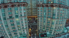 Facade of dwelling complex at winter evening. Aerial view Stock Footage
