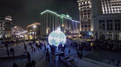 Crowd of people walk near illuminated sphere on Manezhnaya square Stock Footage