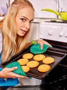 Woman bake cookies - stock photo