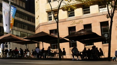 TL General public walk past Lindt Sydney siege cafe 4K Stock Footage
