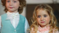 Little cute boy and girl in medieval costumes stands together Stock Footage