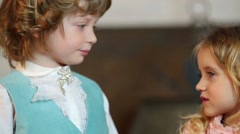 Little cute boy and girl in medieval costumes look at each other Stock Footage
